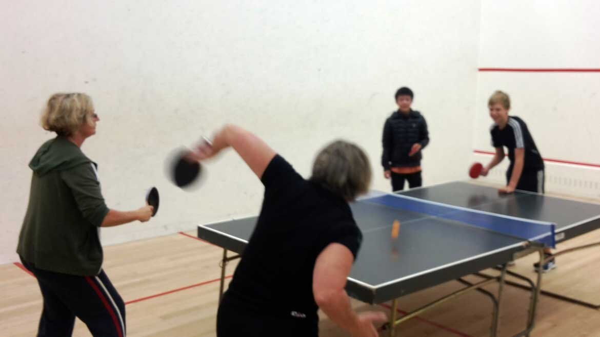 Squash Club Members Partake In A Game Of Table Tennis