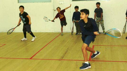 Junior Squash Players Practicing Three Quarter Court